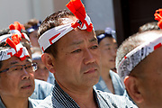 Mikoshi supporters during the Sanja matsuri, Asakusa, Tokyo, Japan. Sunday May 21st 2017. The Sanja matsuri (Three shrines festival) is one of the biggest Shinto festivals in Japan. It takes place for 3 days around the third weekend of May and features over 100 large and small mikoshi, or portable shrines, which are paraded around the streets of the historic Asakusa district in Tokyo. to bring blessings and good luck on the inhabitants. The events attracts up to 2 million visitors each year.