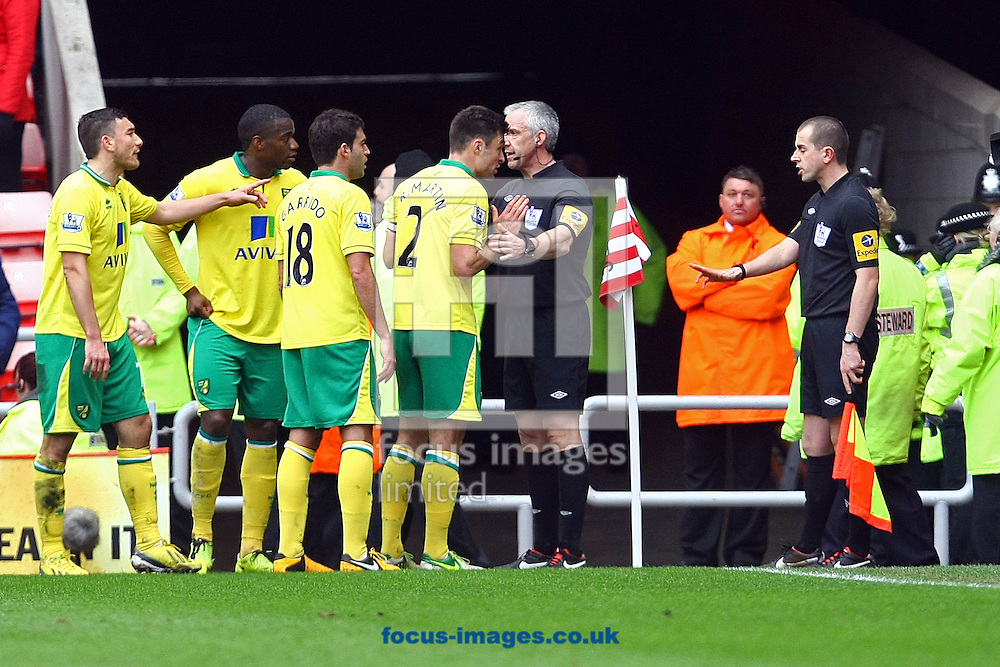 Picture by Paul Chesterton/Focus Images Ltd +44 7904 640267.17/03/2013.The Norwich players protest to Referee Chris Foy about the award of a penalty against them during the Barclays Premier League match at the Stadium Of Light, Sunderland.