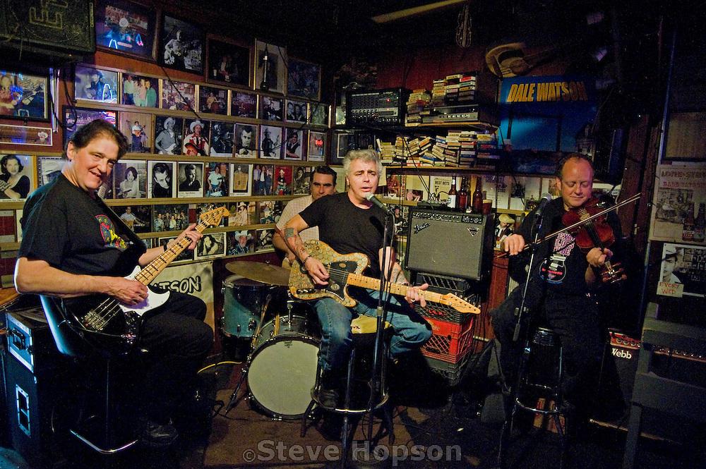Dale Watson performing at Ginny's Little Longhorn Saloon, Austin Texas, March 8, 2009. Gene Kurtz accompanies Watson on Bass.