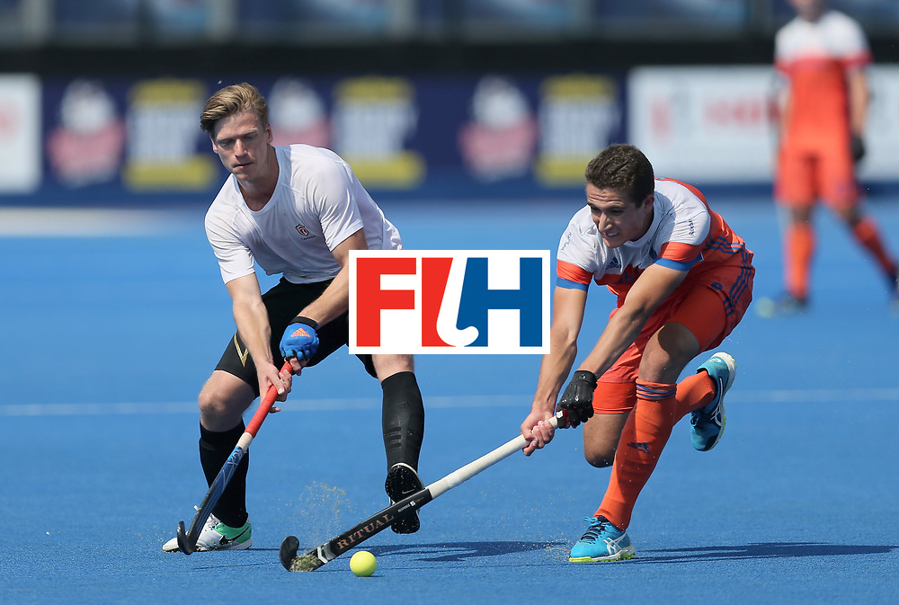 LONDON, ENGLAND - JUNE 19:  Foris Van Son of Canada and Jonas de Geus of the Netherlands battle for possesion during the Hero Hockey World League Semi-Final match between Netherlands and Canada at Lee Valley Hockey and Tennis Centre on June 19, 2017 in London, England.  (Photo by Alex Morton/Getty Images)