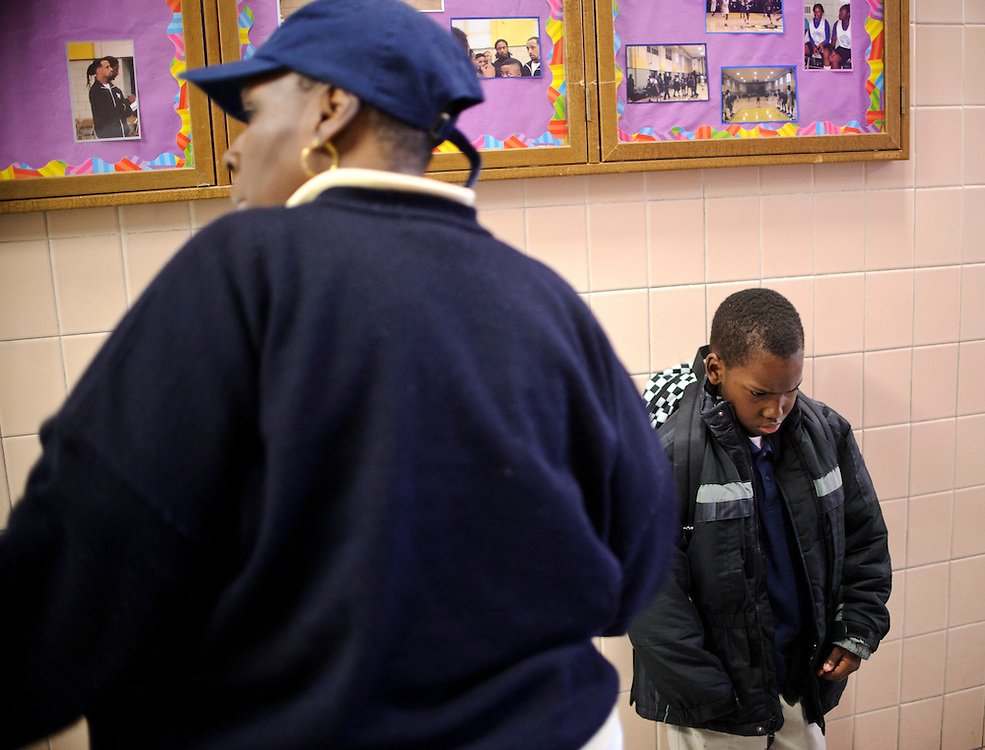 Photo copyright 2009, Matt Roth<br /> Wednesday, February 29, 2012<br /> <br /> City Springs Elementary School first grader Jahmal Harrison, right, is scolded by his mother Tameka Harrison, after she found out he was in a fight with another student. Tameka, who can't work due to a facial injury, volunteers at her son's school where poverty is the norm. Ninety-six percent of the student body qualifies for free lunches. Tameka and Jahmal, who suffers from lead poisoning, used to live in one of the close-by housing projects, but have been homeless for the last two months. They're currently staying at Sarah's Hope Shelter in West Baltimore.