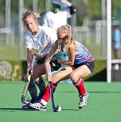 Mia Kruger of the Dragons, and Francis Bolton of Heat fight for possession on the first day of the Super 5's junior tournament, held at the Hartleyvale stadium in Cape Town. The tournament ends on Saturday.