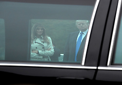 United States President Donald J. Trump and First lady Melania Trump are framed through the window of the limousine that was used by United States President Bill Clinton as they tour the US Secret Service James J. Rowley Training Center in Beltsville, Maryland on Friday, October 13, 2017.<br /> (Photo by Ron Sachs/CNP/Sipa USA)