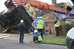 Basingstoke,Hampshire Thursday 2nd November 2017  Emergency Services rush to the scene of a crane that have crashed into a house in Basingstoke. One Person has been free by Hampshire Fire and Rescue and taken to hospitial. The incident happened just after 9.30am this morning, whilst the driver was trying to following goods into the rear of the property.©UKNIP
