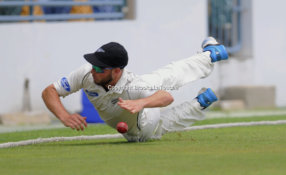 New Zealand bowler Mark Craig stops the ball from crossing the boundary during day three of the Third and Final Test West Indies v New Zealand at Kensington Oval, Barbados.<br /> Photo: Randy Brooks/www.photosport.co.nz