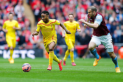 Raheem Sterling of Liverpool is challenged by Ron Vlaar of Aston Villa - Photo mandatory by-line: Rogan Thomson/JMP - 07966 386802 - 19/04/2015 - SPORT - FOOTBALL - London, England - Wembley Stadium - Aston Villa v Liverpool - FA Cup Semi Final.