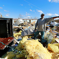 Thomas Wells   BUY AT PHOTOS.DJOURNAL.COM<br /> Will Poplar of Walnut digs through what's left of his mobile home along Highway 72 on Monday as he tries to recover any of his belongings following last weeks tornado. Poplar was in the home at the time of the storm and suffered a fractured hip as his only major injury.