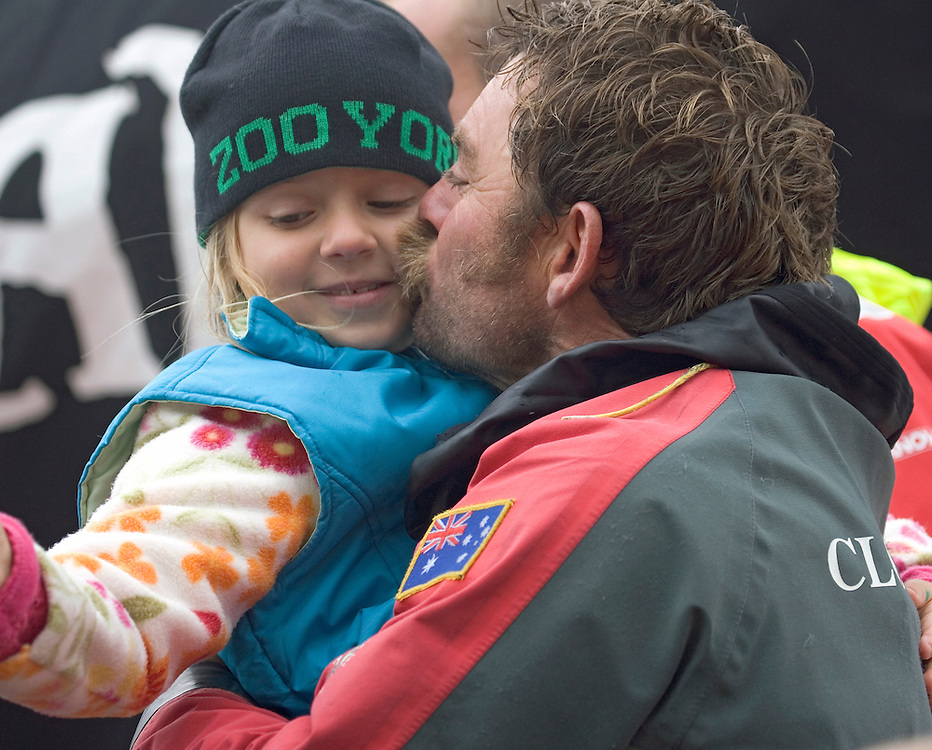 Justin Clougher, bowman for Pirates of the Caribbean greets his daughter on the dock in Portsmouth after finishing Leg 7 in 3rd place, Volvo Ocean Race 2005-6