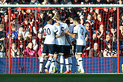 Tottenham Hotspur players celebrate their first goal during the Barclays Premier League match between Bournemouth and Tottenham Hotspur at the Goldsands Stadium, Bournemouth, England on 25 October 2015. Photo by Mark Davies.