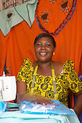 Anna Nyamanda pictured with her sewing machine<br /> <br /> Anna set up and now runs a tailoring business selling a variety of home furnishings in Mwanalugali, Tanzania.<br /> <br /> She attended MKUBWA enterprise training run by the Tanzania Gatsby Trust in partnership with The Cherie Blair Foundation for Women.