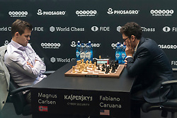 © Licensed to London News Pictures. 28/11/2018. LONDON, UK.  Magnus Carlsen (L) of Norway competes against Fabiano Caruana (R) of the United States in a quickfire series of tie-breakers to decide the winner of the World Chess Championship at The College in Holborn.  The match is currently tied after 12 draws.  Photo credit: Stephen Chung/LNP
