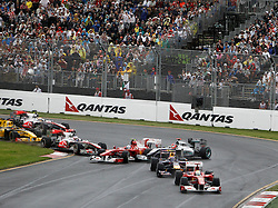 MELBOURNE, AUSTRALIA - Saturday, March 28, 2009: Fernando Alonso (Ferrari) and Michael Schumacher (Mercedes GP) collide during a multi-car crash at the start of the Australian Grand Prix at the Melbourne Grand Prix Circuit. (Pic by Juergen Tap/Propaganda/Hoch Zwei)