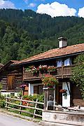 Typical Swiss wooden chalet style house in Serneus near Klosters in Graubunden region, Switzerland