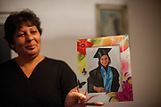 Proud mother Ivana Budrega with a graduation image of her daughter Cornelia - a 22 years old Roma student in the house of her parents. She is is studying Commercial Business Administration in a Master Degree Program in Bucharest and never experienced any kind of discrimination because of being a Roma.