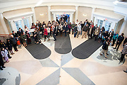 Participants gather inside the fourth floor of Baker University Center on Monday, January 19 at the conclusion of a silent march in honor of Dr. Martin Luther King Jr. The march was led by members of the Alpha Phi Alpha fraternity.