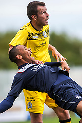 Queen of the South's Andy Dowie holds Falkirk's Phil Roberts.<br /> Falkirk 2 v 1 Queen of the South, Scottish Championship 5/10/2013, played at The Falkirk Stadium.<br /> &copy;Michael Schofield.