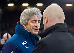 West Ham United manager Manuel Pellegrini (L) and Burnley manager Sean Dyche - Mandatory by-line: Jack Phillips/JMP - 30/12/2018 - FOOTBALL - Turf Moor - Burnley, England - Burnley v West Ham United - {event}