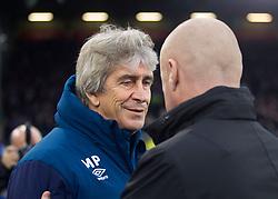 West Ham United manager Manuel Pellegrini (L) and Burnley manager Sean Dyche - Mandatory by-line: Jack Phillips/JMP - 30/12/2018 - FOOTBALL - Turf Moor - Burnley, England - Burnley v West Ham United - {event}