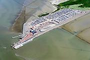 Nederland, Friesland, Gemeente Dongeradeel, 05-08-2014; veerdam Holwerd voor veerdienst naar Ameland. Parkeerterreinen<br /> Ferry dam Holwerd for ferry to Ameland. Parking spaces.<br /> luchtfoto (toeslag); aerial photo (additional fee required); foto Siebe Swart / photo Siebe Swart