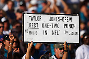 JACKSONVILLE, FL - DECEMBER 9: A Jacksonville Jaguars fan holds up a sign referencing arguably the best one-two punch of running backs, Maurice Jones-Drew and Fred Taylor, in the National Football League during the game against the Carolina Panthers at Jacksonville Municipal Stadium on December 9, 2007 in Jacksonville, Florida. The Jaguars defeated the Panthers 37-6. ©Paul Anthony Spinelli