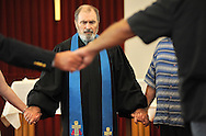 13 MAY 2012 -- FESTUS, Mo. -- The Rev. Bill Charlton leads worshipers in prayer during the final church service at the First Presbyterian Church in Festus Sunday, May 13, 2012. The congregation is merging with nearby Grace Presbyterian Church in neighboring Crystal City, and the Rev. Charlton is retiring. Photo © copyright 2012 Sid Hastings.