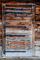 Mt. Rigi, Central Switzerland. Old wooden weathered door on a tradition barn.