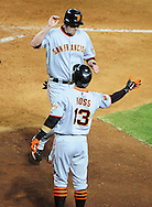 June 14 2011; Phoenix, AZ, USA; San Francisco Giants base runner Aubrey Huff (17) is congratulated by teammate Cody Ross (13) during the seventh inning against the Arizona Diamondbacks at Chase Field. The Giants defeated the Diamondbacks 6-5.  Mandatory Credit: Jennifer Stewart-US PRESSWIRE..