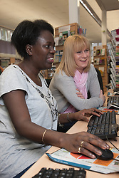 Women using computers in a library.