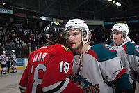 KELOWNA, CANADA - APRIL 25: Carter Rigby #11 of the Kelowna Rockets shakes hands with Garrett Haar #18 of the Portland Winterhawks on April 25, 2014 during Game 5 of the third round of WHL Playoffs at Prospera Place in Kelowna, British Columbia, Canada. The Portland Winterhawks won 7 - 3 and took the Western Conference Championship for the fourth year in a row earning them a place in the WHL final.  (Photo by Marissa Baecker/Getty Images)  *** Local Caption *** Carter Rigby; Garrett Haar;