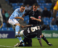 Photo: Paul Thomas.<br />Manchester City v Scunthorpe United. The FA Cup.<br />07/01/2006.<br />Man City's Lee Croft (L) gets tackled by Andy Crosby and Cleveland Taylor.