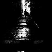 Woman in Hat walks through allyway at Night, Croatia