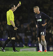 Picture by David Horn/Focus Images Ltd +44 7545 970036<br /> 13/09/2013<br /> Adam Thompson of Southend United is booked for a foul on Sam Winnall of Scunthorpe United (not pictured) during the Sky Bet League 2 match at Roots Hall, Southend.