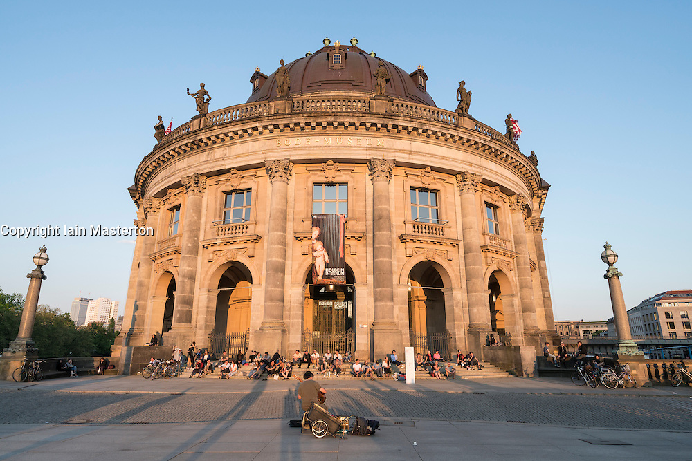 Musician busking in from of Bode Museum in the evening at Museum Island in Berlin Germany