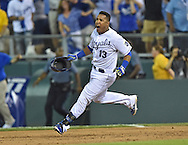 Sep 30, 2014; Kansas City, MO, USA; Kansas City Royals Catcher Salvador Perez (13) reacts after hitting a walk off single to beat the Oakland Athletics in extra innings during the 2014 American League Wild Card playoff baseball game at Kauffman Stadium. Mandatory Credit: Peter G. Aiken-USA TODAY Sports