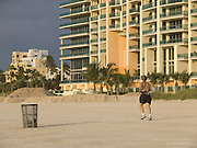 Man running on the beach of Miami Beach USA