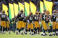 GREEN BAY, WI - OCTOBER 17: Players of the Green Bay Packers before the game against the Miami Dolphins at Lambeau Field on October 17, 2010 in Green Bay, Wisconsin. The Dolphins defeated the Packers 23-20 in overtime. (Photo by Tom Hauck/Getty Images) *** Local Caption ***