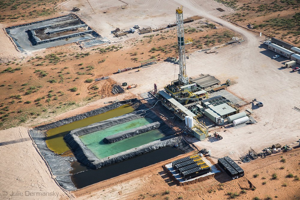 Aerial view of a drilling rig at a frack site in Midland,Texas in the Permian Basin.