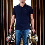 NYTIMES ASSIGNMENT ID: 30130161A     Assigning Editor: Brad Smith<br /> SLUG:MITCH<br /> August 16, 2012<br /> Former NFL player Mitch White holds the helmets of the two teams he played for in the National Football League.  White now suffers daily with headaches from his years playing football and taking hits to the head.   White played for both the New Orleans Saints and the Tampa Bay Buccaneers.  His severe headaches began while he was with the Buccaneers in 2005.  White took a hard hit to the head during an offseason practice and never played again.  White lives in Keller, Texas now with his wife and two children.  They are expecting a third child.