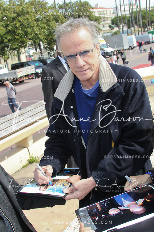 CANNES, FRANCE - APRIL 08:  Christophe Lambert signing autographs after 'La Source' Photocall on the Croisette during the 50th MIPTV  on April 8, 2013 in Cannes, France.  (Photo by Tony Barson/Getty Images)