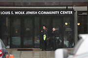 Police search a Jewish Community Center after a bomb threat was reported in the Rochester suburb of Brighton, New York, U.S. March 7, 2017.  REUTERS/Mike Bradley