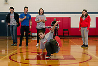 Elijah Perez shows off his dance moves for Justin Spencer of Recycled Percussion during their surprise visit to Laconia Middle School Monday afternoon.  (Karen Bobotas/for the Laconia Daily Sun)