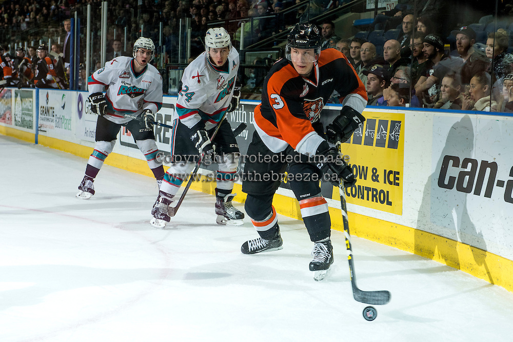 KELOWNA, CANADA - JANUARY 23: Tyson Baillie #24 of Kelowna Rockets back checks Nick Heid #3 of Medicine Hat Tigers as he skates with the puck on January 23, 2016 at Prospera Place in Kelowna, British Columbia, Canada.  (Photo by Marissa Baecker/Shoot the Breeze)  *** Local Caption *** Tyson Baillie; Nick Heid;