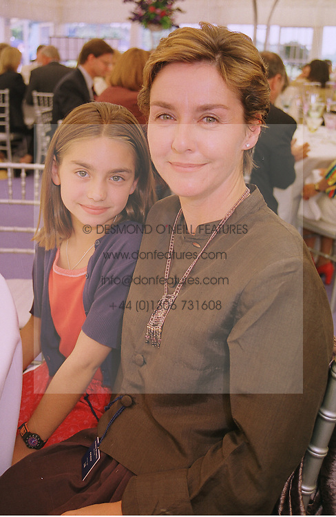 Actress AMANDA BURTON and her daughter MISS PHOEBE ARNSTEIN, at a polo match in Berkshire on 13th June 1999.MTD 88