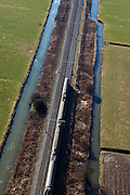 Nederland, Gelderland, Gemeente Maasdriel, 07-03-2010; spoorlijn Utrecht - Den Bosch, Bommelerwaard.luchtfoto (toeslag), aerial photo (additional fee required).foto/photo Siebe Swart