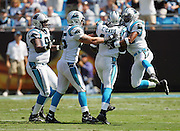 CHARLOTTE, NC - SEPTEMBER 18:  Safety Thomas Davis #47 of the Carolina Panthers celebrates with teammates after sacking quarterback Tom Brady #12 of the New England Patriots at Bank of America Stadium on September 18, 2005 in Charlotte, North Carolina. The Panthers defeated the Patriots 27-17. ©Paul Anthony Spinelli *** Local Caption *** Thomas Davis