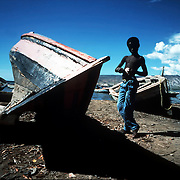 A young Haitian boy in the fishing village of Gonaives. ©Ed Hille