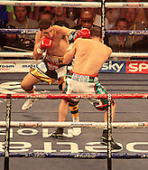 Picture by Richard Gould/Focus Images Ltd +44 7855 403186<br /> 13/07/2013<br /> Tommy Coyle (gold & black) and Derry Mathews fight for the vacant Commonwealth Lightweight title at Craven Park, Hull.