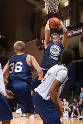 C Brennan Cougill (Sioux City, IA / Bishop Heelan) grabs a rebound.  The NBA Player's Association held their annual Top 100 basketball camp at the John Paul Jones Arena on the Grounds of the University of Virginia in Charlottesville, VA on June 20, 2008