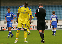 Photo: Frances Leader.<br />Millwall v Cardiff City. Coca Cola Championship.<br />24/09/2005.<br /><br />Cardiff's Michael Ricketts gets a warning from the ref.