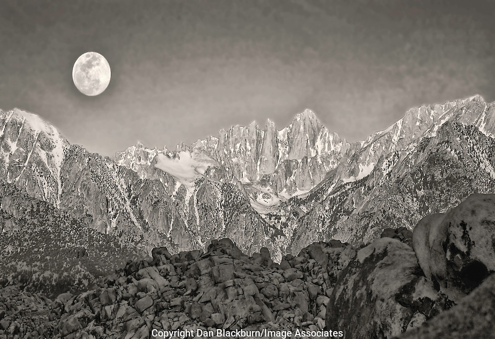 A Full Moon Sets Next to Mount Whitney in the Sierra Nevada Range of California